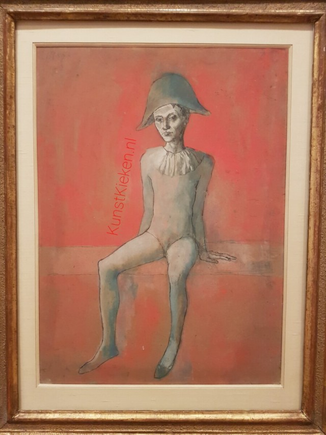Seated Harlequin - Picasso