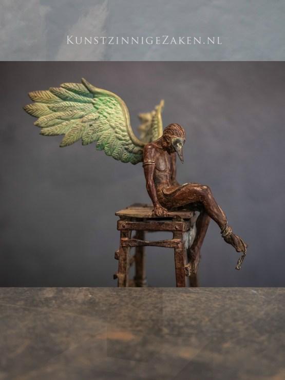 Bronzen beeld Daedalus op toren
