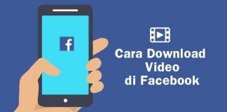 ponsel di tangan dengan logo facebook