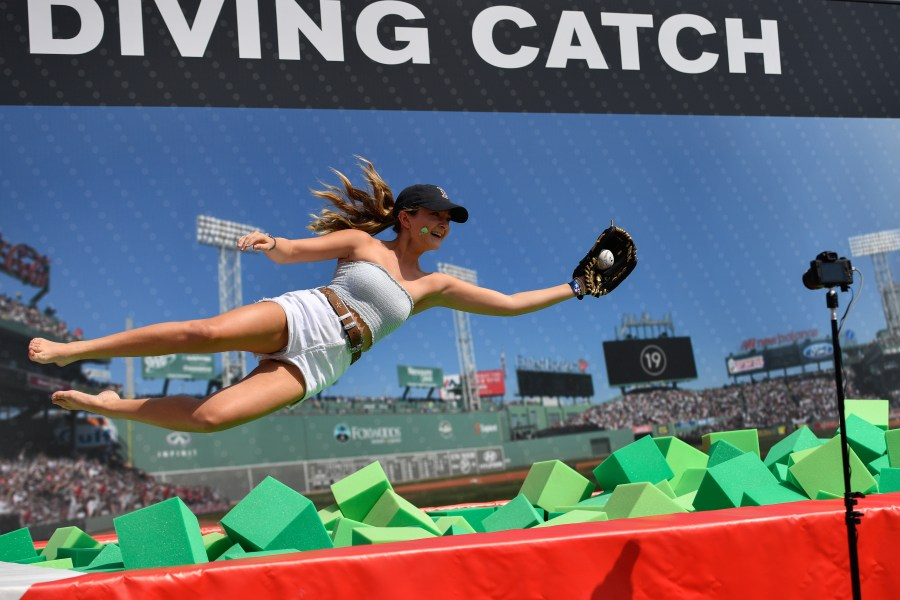 A fan makes a diving catch in the