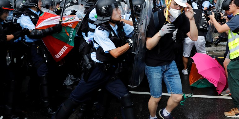 Riot Police Meet Hong Kong Protesters with Pepper Spray, Batons