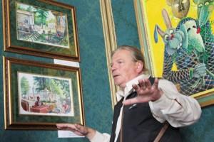 Malarz Ojaras Mašidlauskas w swych obrazach odtwarza sceny z przedwojennego życia pałacu Fot. Marian Paluszkiewicz