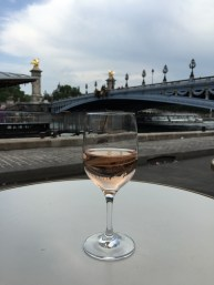Sipping a rosé by the Pont Alexandre III in Paris, France.