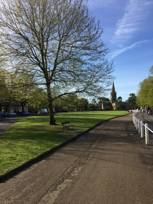 Trekking along the Church Green in Witney, England.