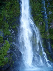 Admiring the 151-metre Stirling Falls in Milford Sound, in the Fiordland National Park, New Zealand.