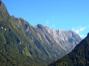 Admiring the picturesque mountains in Milford Sound, in the Fiordland National Park, New Zealand.