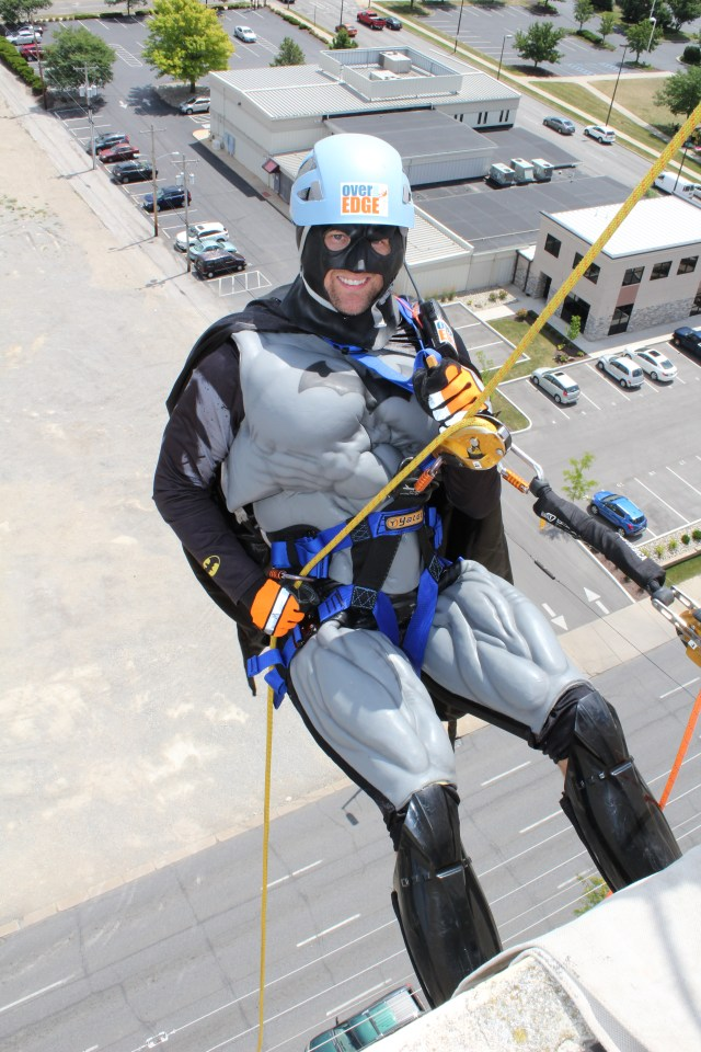 Batman rappelling over the edge