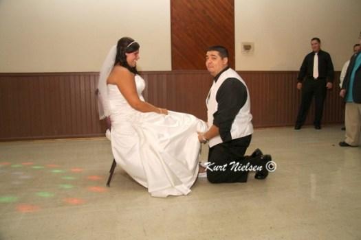 Groom finding bride's garter