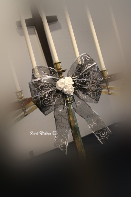 Silver bow on Candelabrum