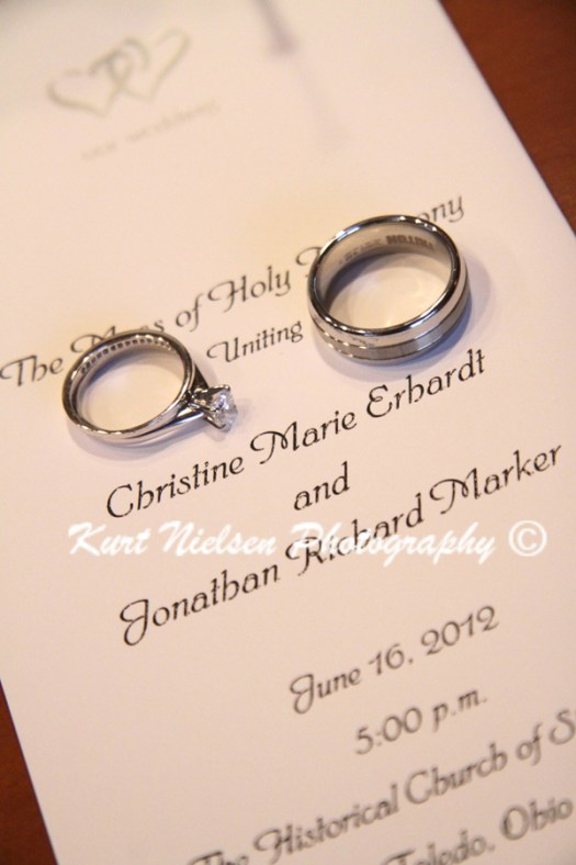 wedding rings and wedding program