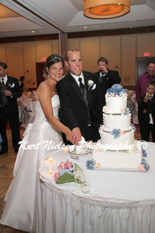 wedding cake with real blue flowers