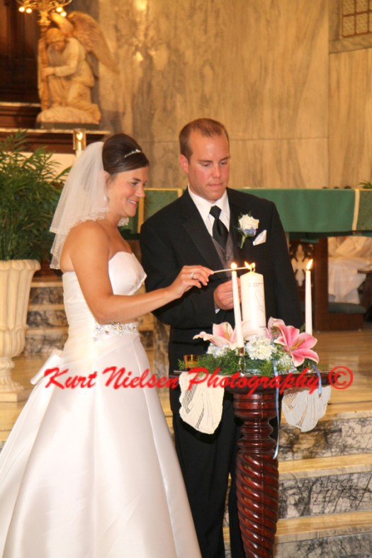wedding couple lighting unity candle