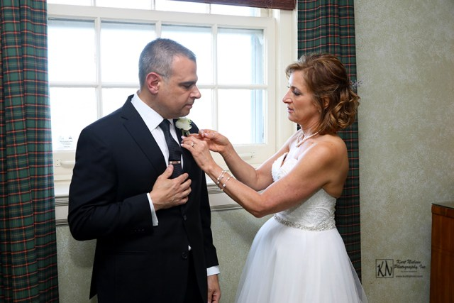 who helps the groom put on his boutonniere