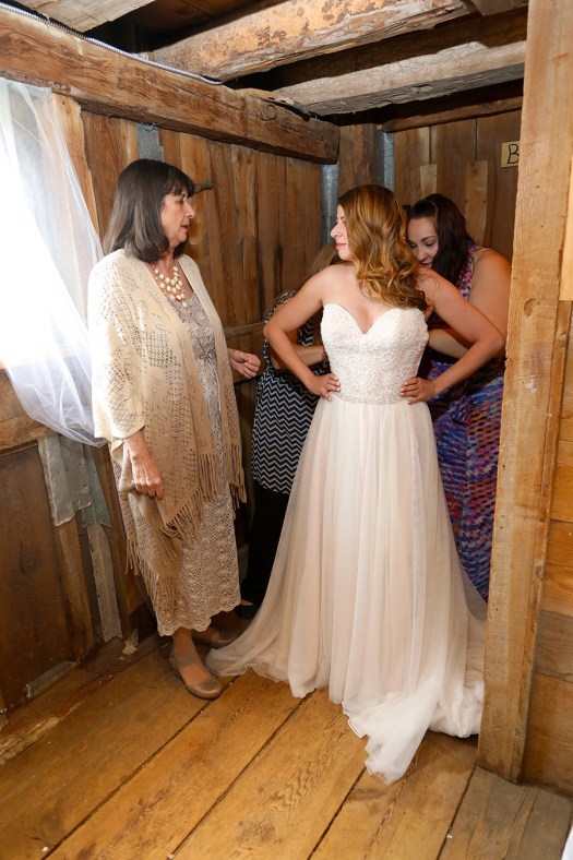 helping the bride get into her gown photos