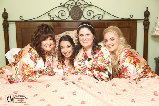 bridesmaids in the king size bed in the Sherwin Suite at the Club at Hillbrook