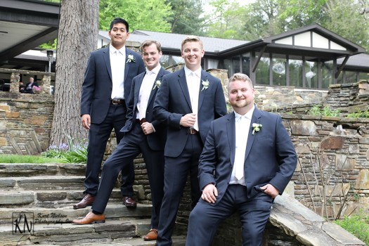 casual poses of the groom and his groomsmen
