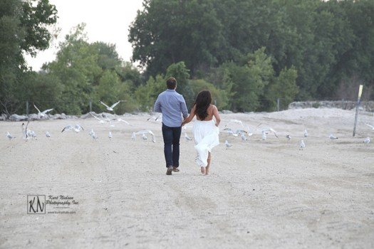 engagement photos taken on the shores of Lake Erie