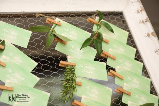 leafy green seating cards with white lettering from minted