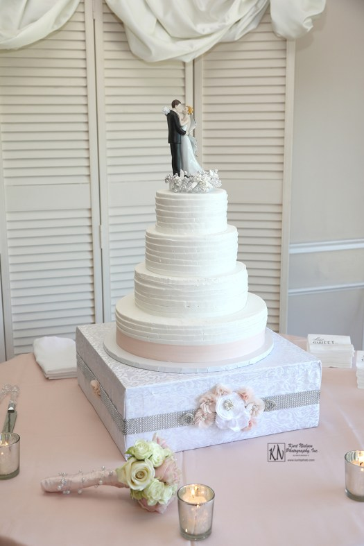 classic 4 tier wedding cake from Eston's Bakery in Toledo Ohio