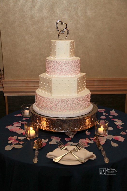 pink and white alternating layers wedding cake