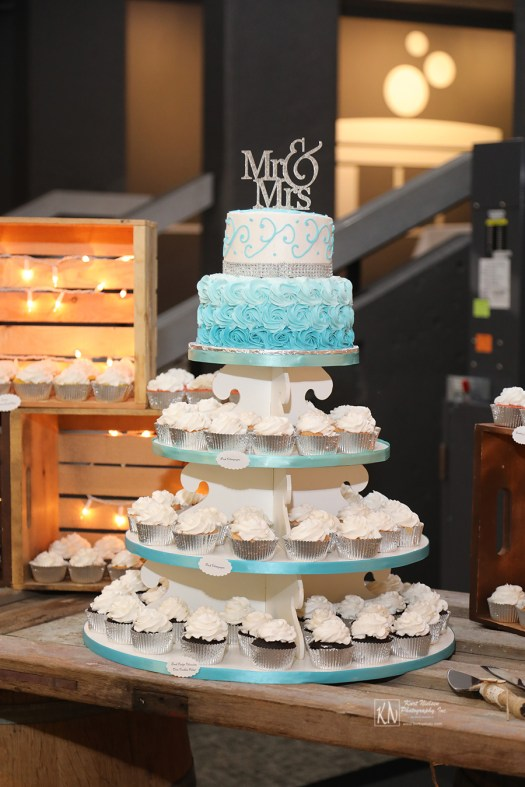 blue ombre rosettes wedding cake and cupcakes