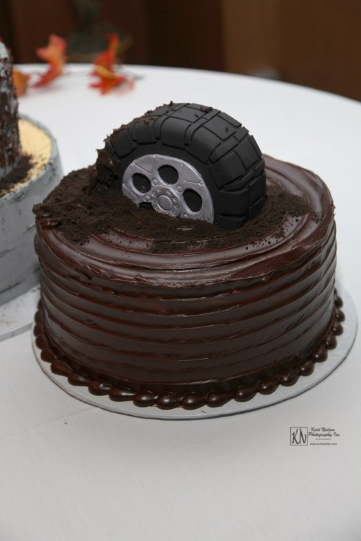 tire stuck in the mud groom's cake