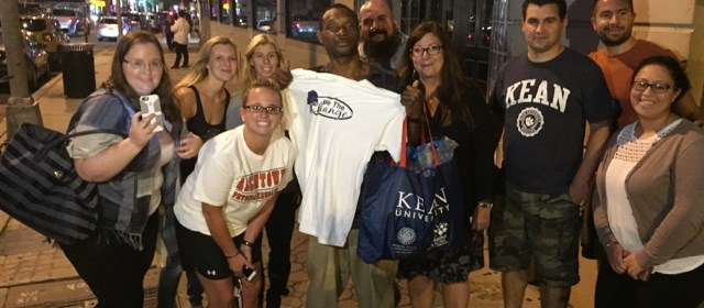 Lee Parker, center holding a t-shirt, stands with members of Be the Change. Photo Courtesy of Norma Bowe