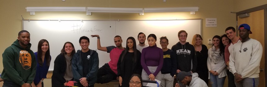 Prof. Allison Edgely, standing third from left, and her group communication class. Credit: Joshua Rosario