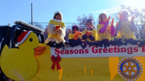 Dr. Susanna Rich, far left, performs her duck anthem with Lakeview Elementary students on the Denville Sunrise Rotary Club's float on Nov. 27, 2016. Photo courtesy of Dr. Rich.
