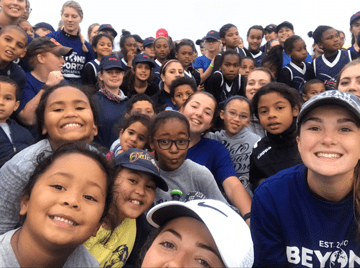 Shannon McMahon taking a group selfie with her, Olivia Zengel, and the young aspiring softball players from South Africa Credit: Shannon McMahon
