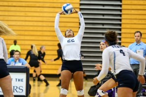 Kendall Sonico (senior) sets the ball for her teammate. Credit: Larry Levanti