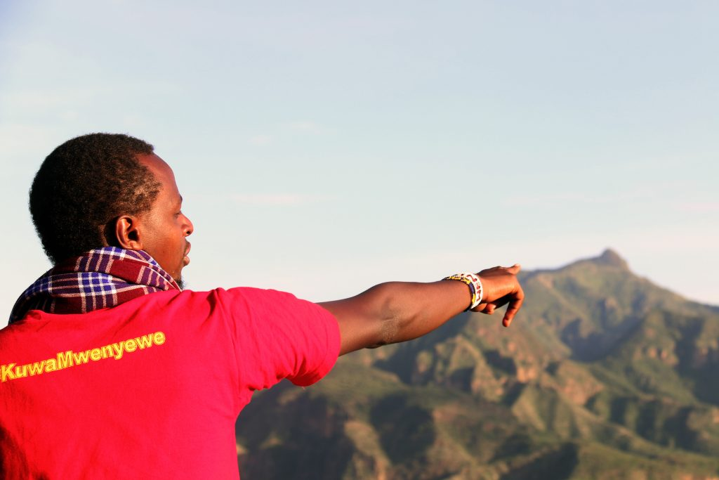 Obsurvative Kimutai on Kamrio Viewpoint facing Mt Tiaty.