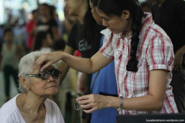 A volunteer Optometrist was seen testing several spectacle grades as she provides free eye checkup to an elderly woman prior to providing her reading glasses.