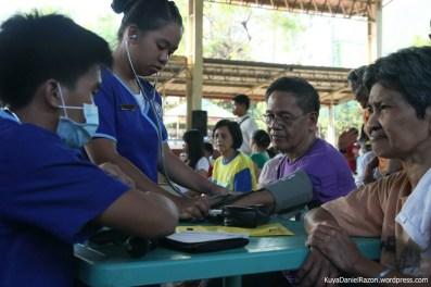 Volunteer nurses perform initial diagnostic procedures on indigent patients consulting during the 3rd People's Day by the UNTV. The quick action of these good samaritans eased the whole process for the people awaiting their turn for free consultation and prescriptioning.