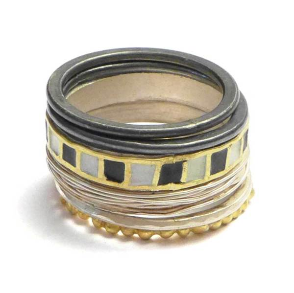 stacking rings black, silver and gold