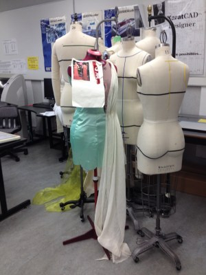 Mannequins are used in a production class.