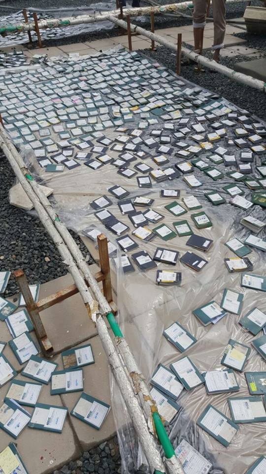 Drying Wet Passports On The Rooftop Due To Heavy Rain And Leak In Kuwait