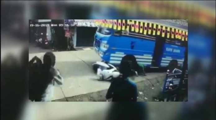 A man in Kerala has a dangerous rescue after bus hits, stagnates him along.