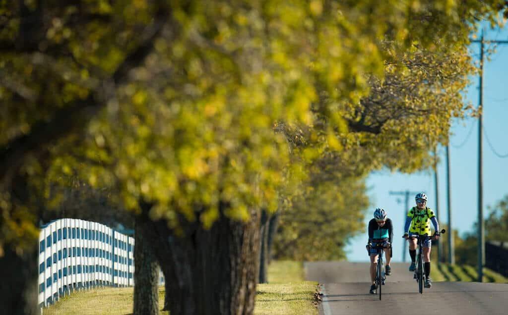 pair biking downhill