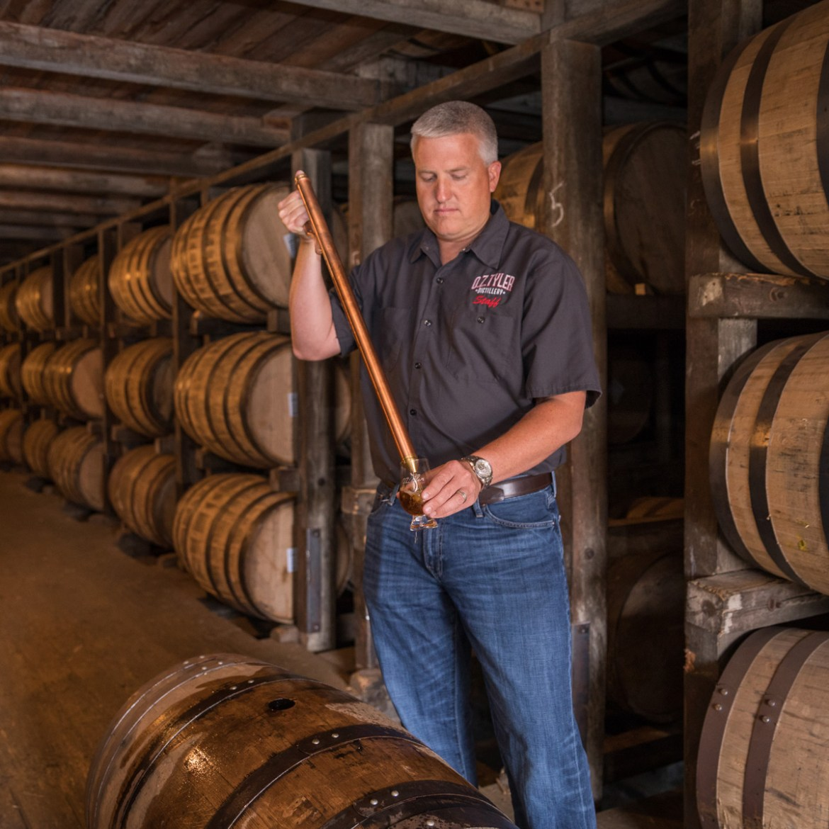Sampling bourbon from the barrels