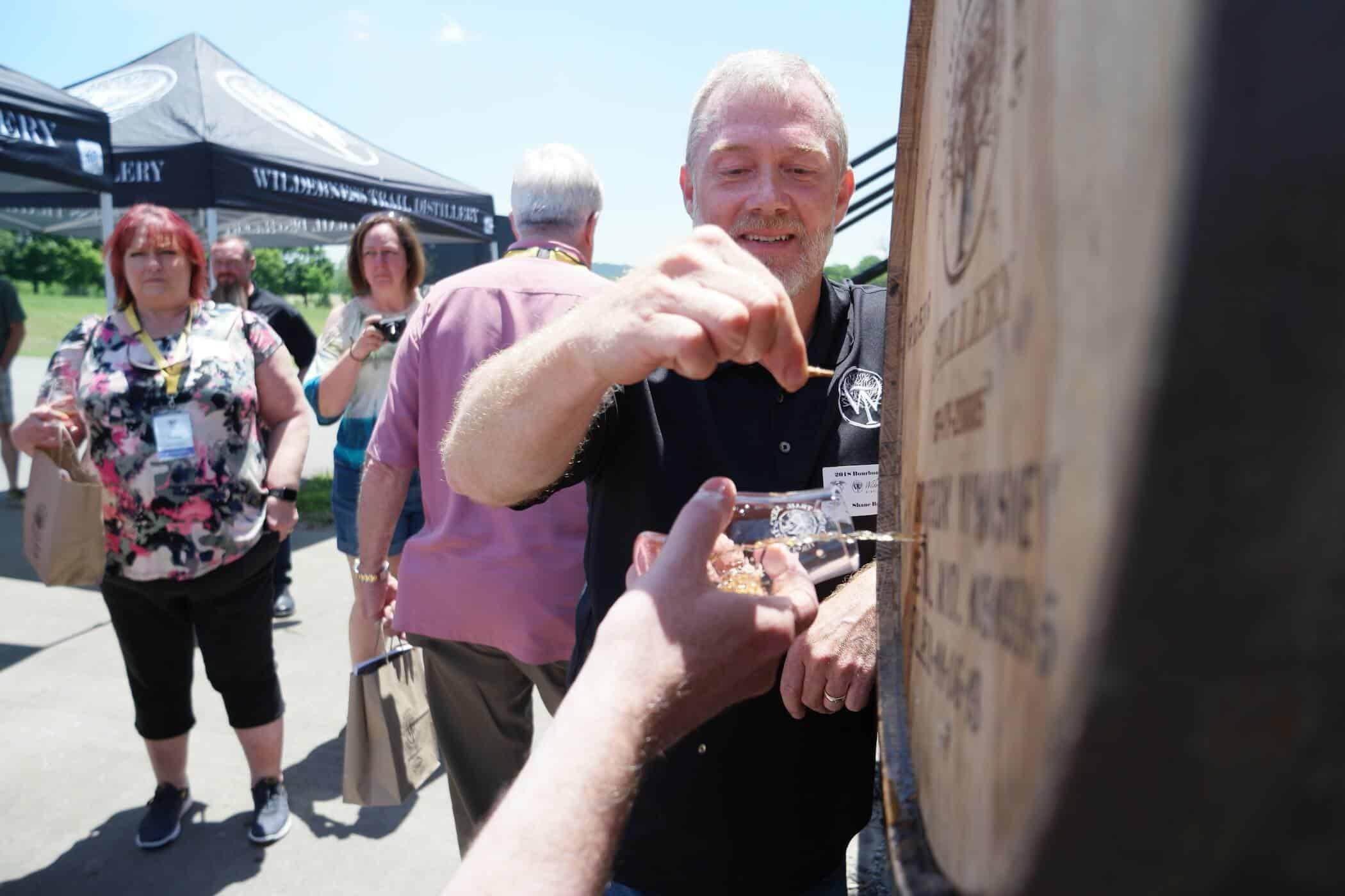 Shane with barrel - Master Distiller Tours