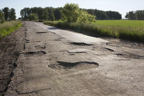 bigstock-broken-fabric-of-rural-roads-i-94845125-2