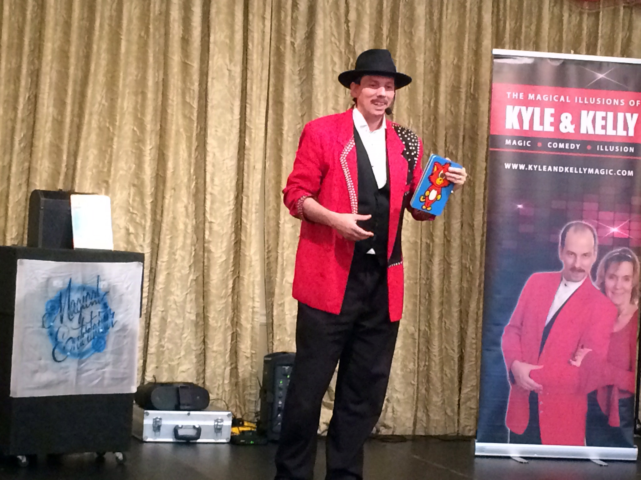 Kyle performing funny magic trick for Birthday party event