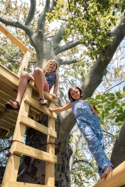 Grace and Rebecca Sikora perched in their treehouse, built into one of the oldest trees in Connecticut. Black Rock, Conn, July 26, 2016.
