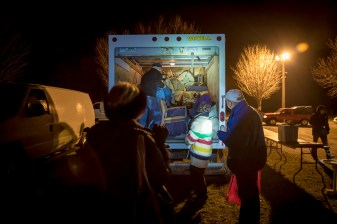 Shortly after vendors arrive to the market early buyers follow, hoping to strike a deal before the sun rises and with it, the crowds. Armed with flashlights, these dedicated collectors, dealers, and enthusiasts begin their search before the vendors have even finished unloading. New Milford, CT on Apr. 10, 2016.