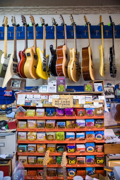 Directly behind the register, every kind of guitar and guitar strings imaginable at the Music Guild in Danbury, Conn. on Oct. 14, 2016.