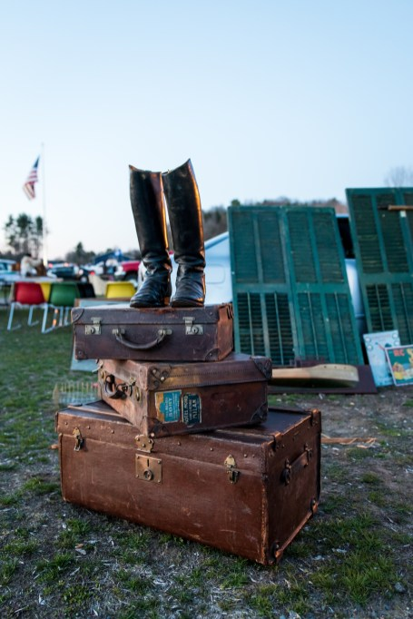 A lone pair of boots stand atop a trio of trunks at the Elephant's Trunk Flea market. Unusual sites such as this are common at the weekly flea market.