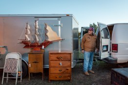 """Chuck Flynn of Shelton, CT, a buyer and reseller who owns Treasures and Things, displays a model ship he hopes will """"sale"""" away by the end of the day."""