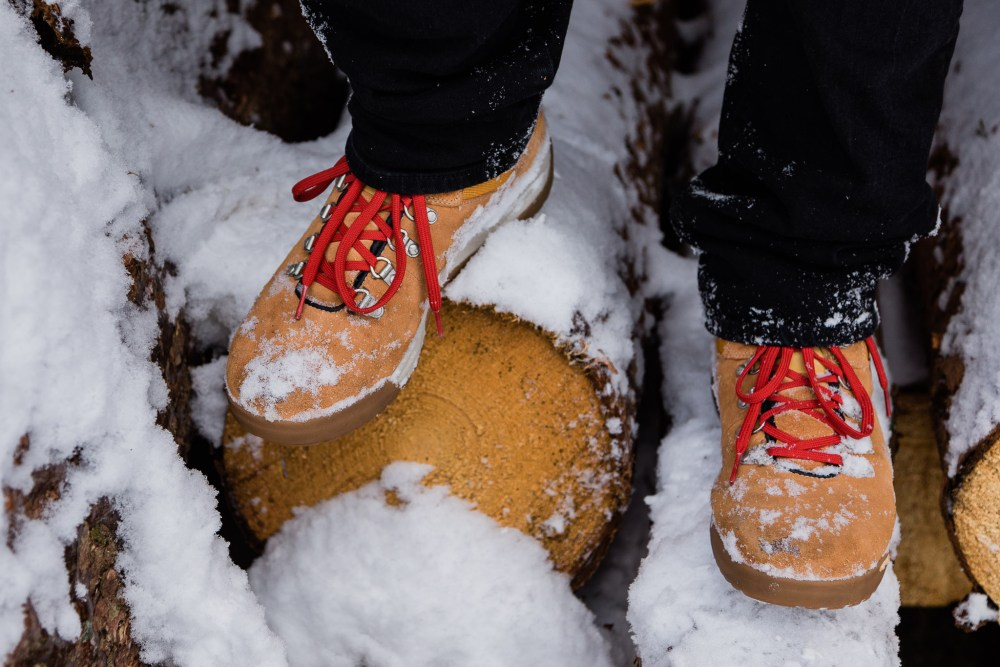 Timberland Boots on snowy logs