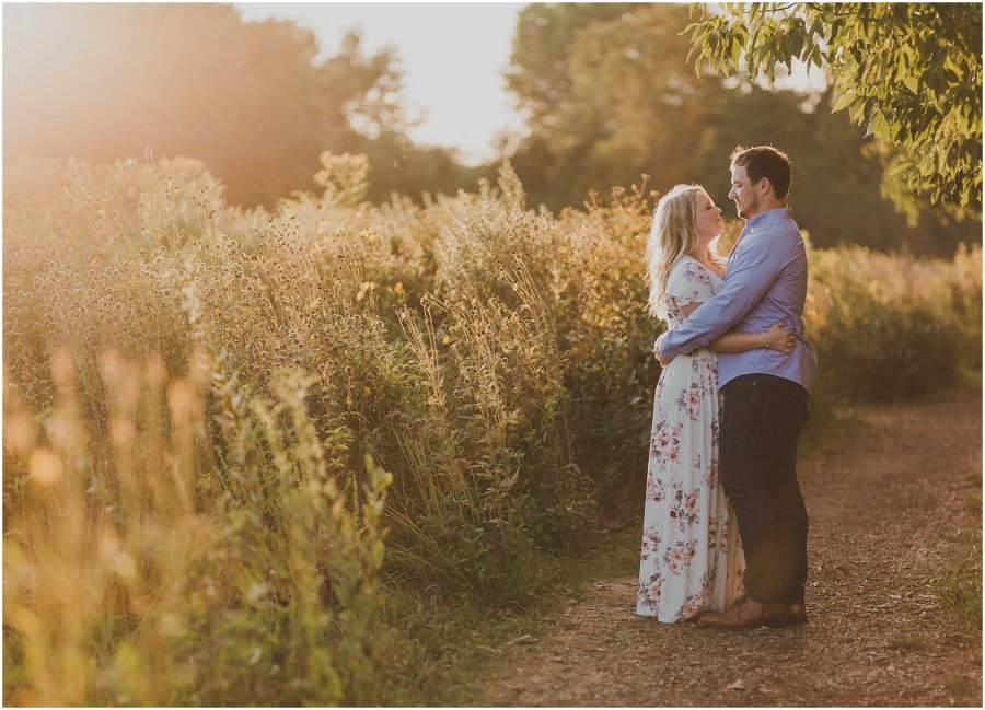Couple standing on a dirt path